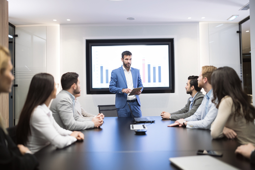 Man giving presentation to associates