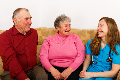 younger woman sitting with older couple
